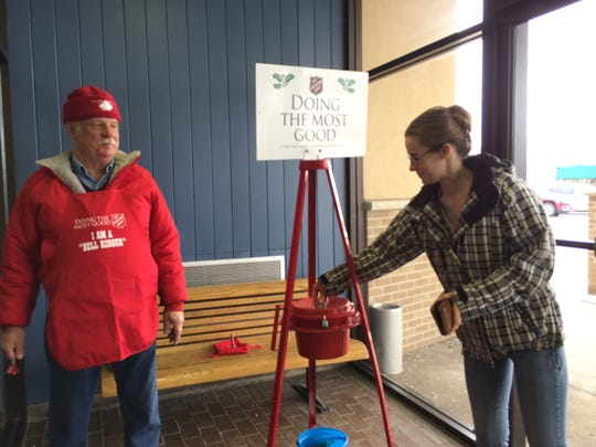 Emily Jinsky of Wisconsin Rapids makes a donation to