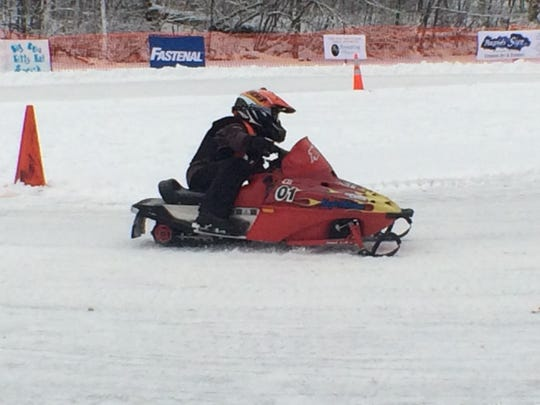 A member of the Big Boy Kitty Kats gets a practice run in before the races start Saturday at Anchor Bay Bar and Grill, 3460 N. Biron Drive, Biron.