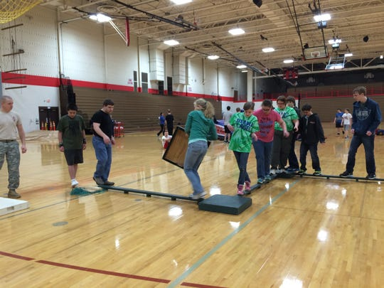Students work on balancing strategies Wednesday, March 4, 2015, at Lincoln High School in Wisconsin Rapids.