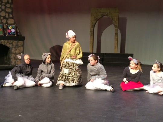 Amelia Marti as Cinderella, center, and her mouse friends
