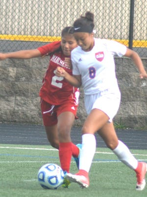Lodi junior Andrea Vasquez (8) trying to work around Manchester's Shirley Montes in the recent division contest.