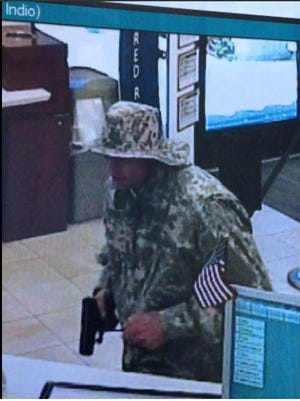 A photo from a security camera shows a man who held up California Bank and Trust in Indio on Friday. Police are still searching for the suspect, who was fully dressed in camouflage.