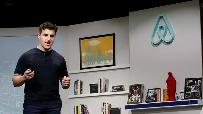 """FILE - In this April 19, 2016, file photo, Airbnb co-founder and CEO Brian Chesky speaks during an event in San Francisco. Airbnb is adding local tours and other activities to its travel services in major cities around the world. With the new features, announced Thursday, Nov. 17, analysts say the fast-growing online rental company is hoping to tap into the desire of leisure travelers for distinctive """"experiences"""" that make them feel more connected with the places they visit. In an interview, Chesky said he hopes to add more services, including the ability to book airline flights."""