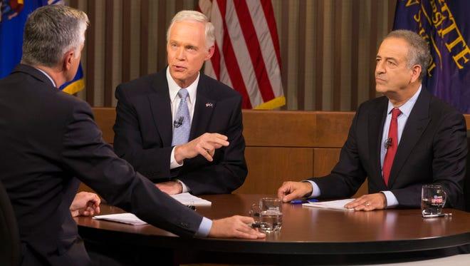 Republican U.S. Sen. Ron Johnson (center) and Democrat Russ Feingold (right) meet in their second and final debate.