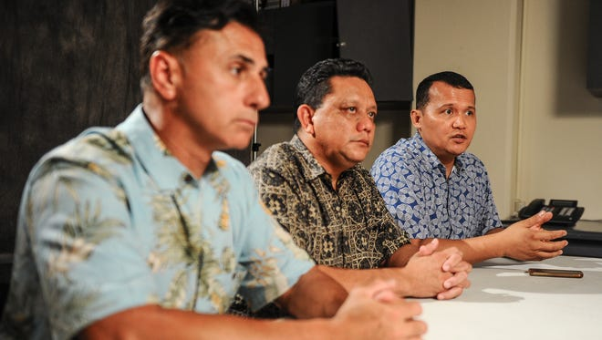 Roy Quintanilla, right, is seated with Walter Denton, left, and Roland Sondia as he expresses his feelings after hearing the comments made by Archbishop Savio Hon Tai Fai during a press conference in Hagåtña on Wednesday, July 27. The three men have come forward and stated allegations of having been sexually abused by Archbishop Anthony Apuron when they served as altar boys at the Agat church in the 70's.