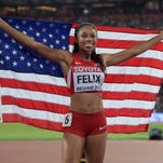 Allyson Felix, seen here posing with the United States flag after winning the womens 400m in 49.26 during the 2015 IAAF World Championships, will be able to attempt the 200- and 400-meter double after a schedule change was announced on Saturday.