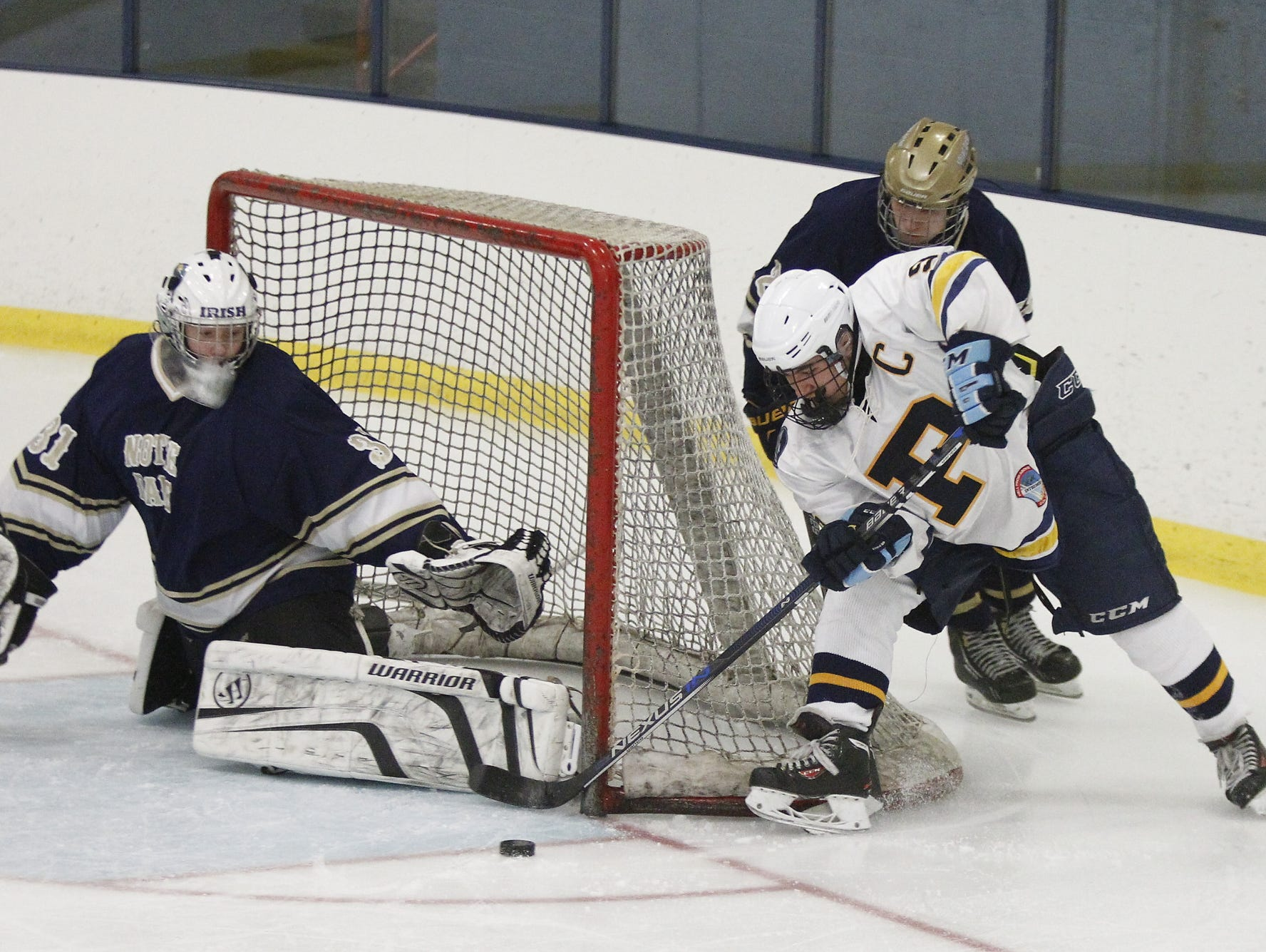 Pelham's Ben Hurd (9) attem[pts a wrap-around shot during their 4-2 win over Notre Dame-Batavia in the division 2 regional finals at Sport-O-Rama Ice Rink in Monsey on Saturday, March 05, 2016.