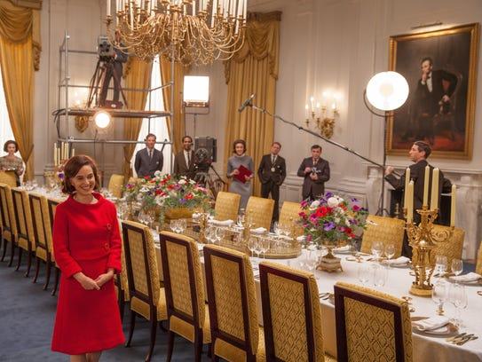 Natalie Portman, as Jackie Kennedy, leads a televised