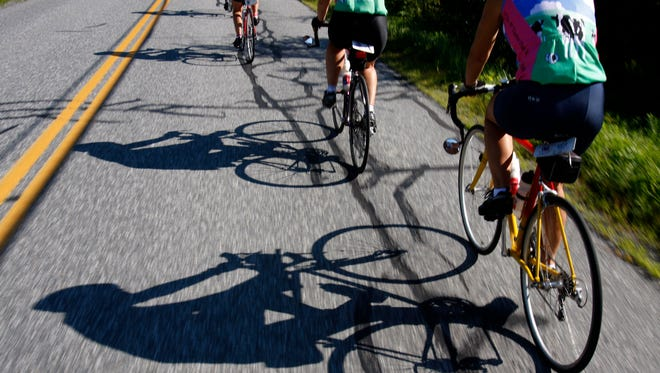 Bicyclists travel north in August 2008 on a main road in South Pomfret, Vt.