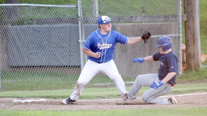 New Franklin third baseman Kaden Sanders applies the tag on Noah Remlinger of Medical Arts in Junior Babe Ruth Thursday night at Twillman field in Harley park. New Franklin, the defending league champions, beat Medical Arts 12-1. In the nightcap, KWRT upended Prairie Home 14-4 in five innings.
