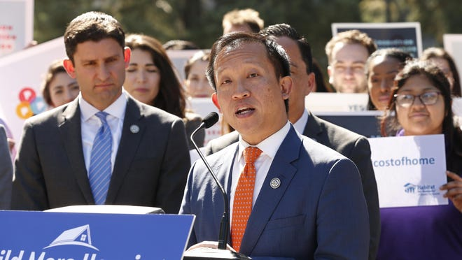 Assemblyman David Chiu, D-San Francisco, chairman of the Assembly housing committee, center, speaks during a news conference in Sacramento in February.