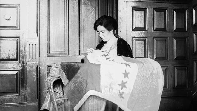 In this 1920s photo, Alice Paul sews a suffrage flag in Washington. One hundred years ago, American women gained the guaranteed right to vote, with ratification of the 19th Amendment. But to suffragist Paul, the vote wasn't enough. She equipped herself with a law degree and got to work writing another constitutional amendment -- one that would guarantee women equal rights under the law.