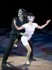 "Frankenstein's monster and the monster's bridge dance during a production of ""Thriller"" at Taucahn Amphitheatre in Ivins City."