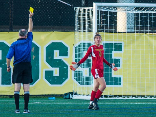 The University of Vermont's Coco Speckmaier gets a yellow card in the match against Marist College in Burlington on Tuesday, September 12, 2017.