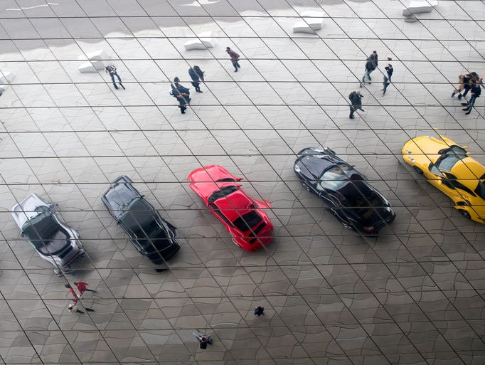 A selection of Porsche cars are reflected in the roof
