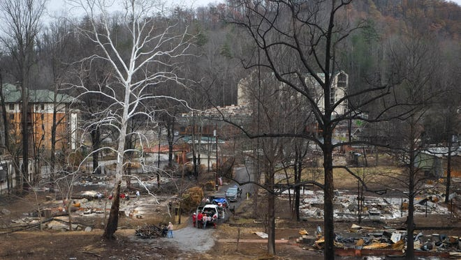 Destroyed structures are pictured along Cherokee Orchard Road on Tuesday, Dec. 20, 2016, in Gatlinburg. The wildfires killed 12 people. One more died of a heart attack and another in a vehicle accident fleeing the blaze. A total of 191 were treated for injuries suffered. More than 2,460 structures were damaged or destroyed.