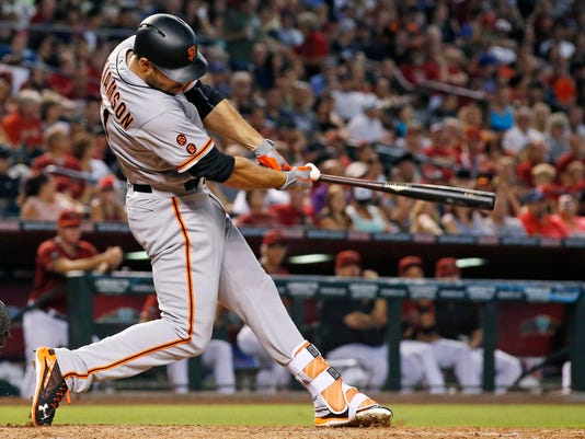 San Francisco Giants' Mac Williamson connects for a two-run single against the Arizona Diamondbacks during the third inning of a baseball game Sunday, July 3, 2016, in Phoenix. (AP Photo/Ross D. Franklin)