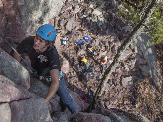 Brad Derickson climbs Foreplay (5.5) at the Bedroom Rocks area of the East Rampart at Devil's Lake State Park.