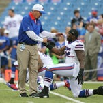 Bills head coach Rex Ryan greets Ikemefuna Enemkpali before the first preseason game against Carolina.