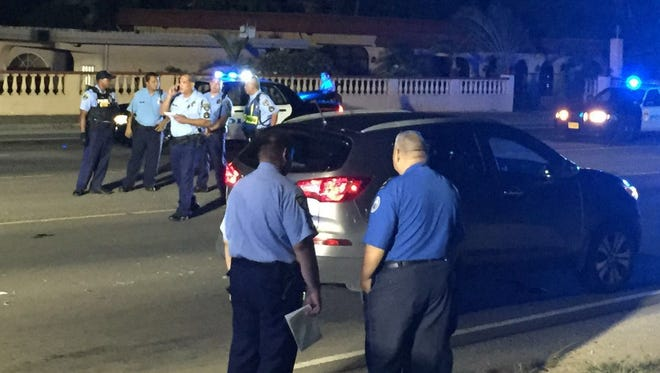 Guam Police Department officers on scene of an auto-pedestrian crash late Tuesday, April 26.