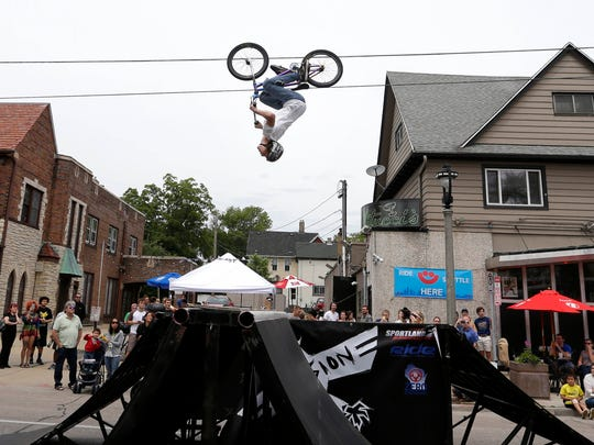 BMX stunt bikers take to the track (and the air) during Summer Soulstice Music Festival on Milwaukee's east side.