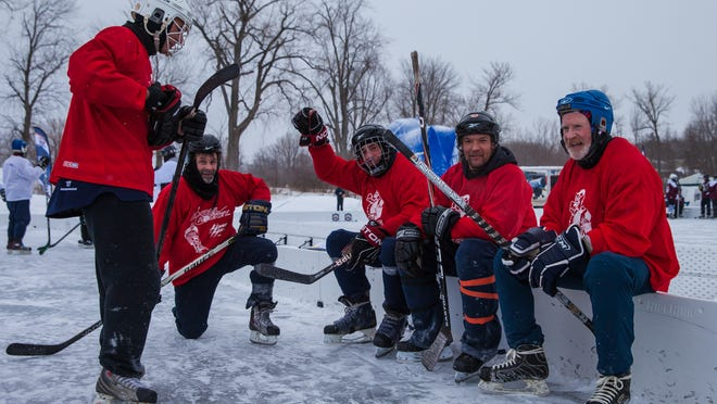 Members of Chazy Chickens Hawks take a rest during a halftime break at the annual Lake Champlain Pond Hockey Classic on frozen Malletts Bay on Saturday.