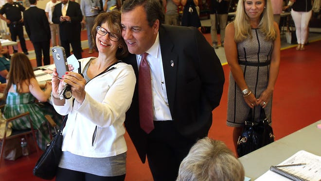 Linda Alexander of Mendham Twp takes a selfie with Governor Chris Christie after before he casts his vote in the Primary Election at the Mendham Twp. Emergency Services Building. June 7, 2016, Mendham, NJ