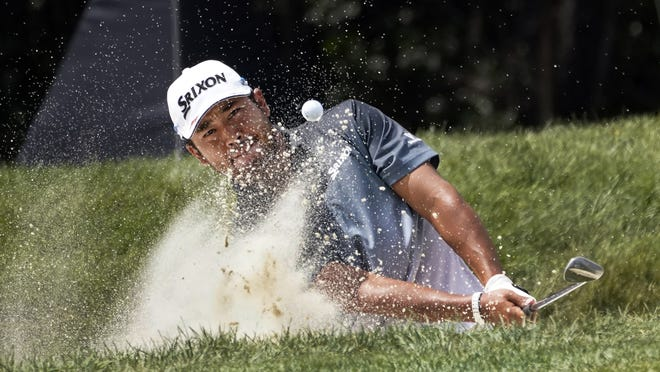 Hideki Matsuyama hits out of the sand for an eagle on the first hole during the third round Saturday at Olympia Fields Country Club.