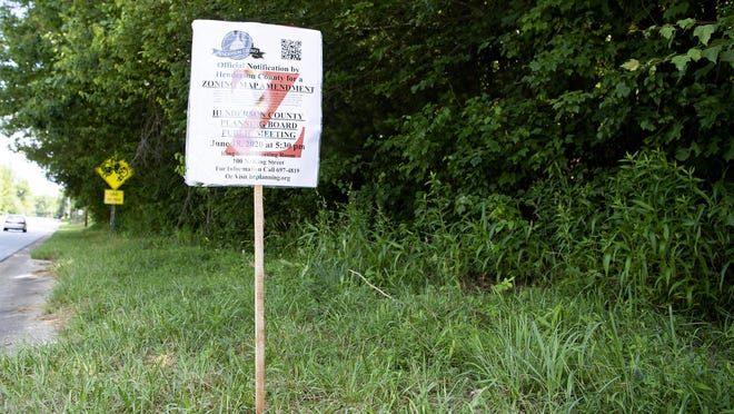 A change in zoning notice for a new SE Asphalt drum plant is posted along the Spartanburg Highway at the proposed site in East Flat Rock on June 12.