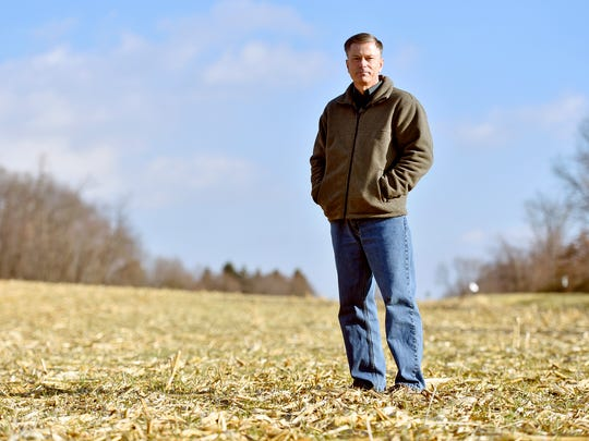 Jerry Otterbein stands for a portrait in a Hellam Township cornfield. Otterbein, a township resident, is concerned about an upcoming township board of supervisors vote to subdivide the township's rural agricultural zone from 204 residential lots to 539, which could affect the municipality's agrarian landscape.