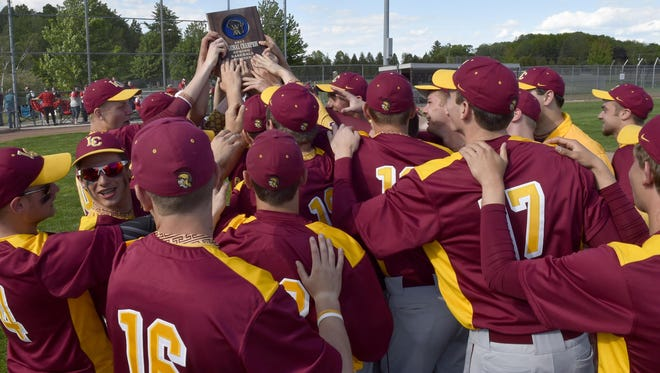 Luxemburg-Casco players hoist the championship plaque after beating Sturgeon Bay, 6-2, in a WIAA Division 2 baseball regional final Wednesday. The Spartans play move on the the sectional tournament with a semifinal Tuesday at Clintonville.