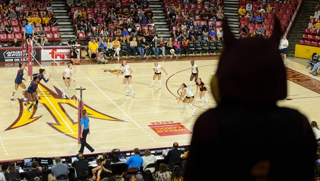 Sparky watches the Arizona State University volleyball team during a Pac-12 volleyball match .