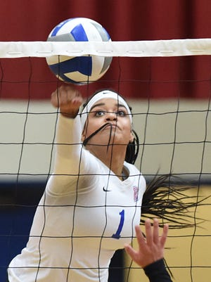 Reno's Kaitlynn Biassou goes for the ball against McQueen in Tuesday's game at Reno. Reno won, 3-2