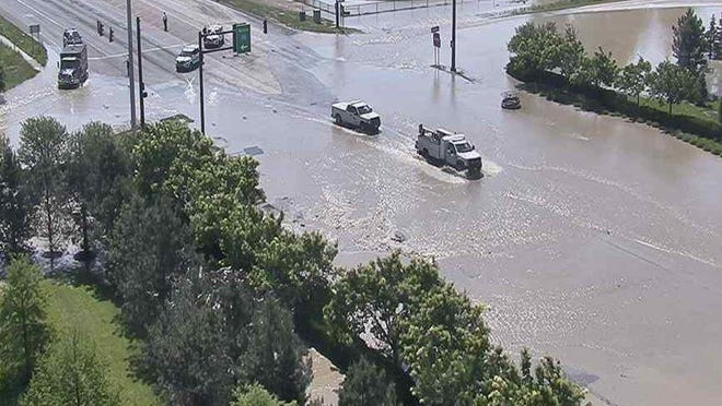 Water covers Morse Road near Interstate 270 on the Northeast Side after a water main broke Tuesday morning.