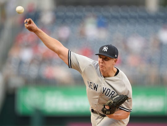 New York Yankees relief pitcher Chad Green delivers