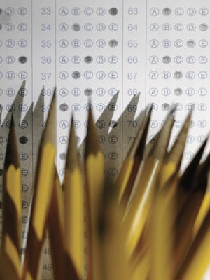 Pencils with standardized test answer sheet