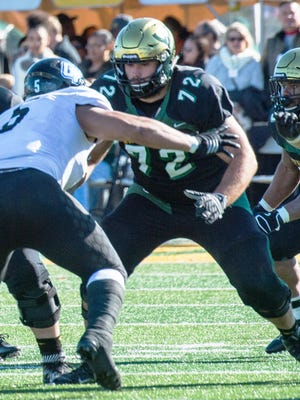Wayne State offensive lineman Nate Theaker (72) signed as an undrafted free agent with the Dallas Cowboys.