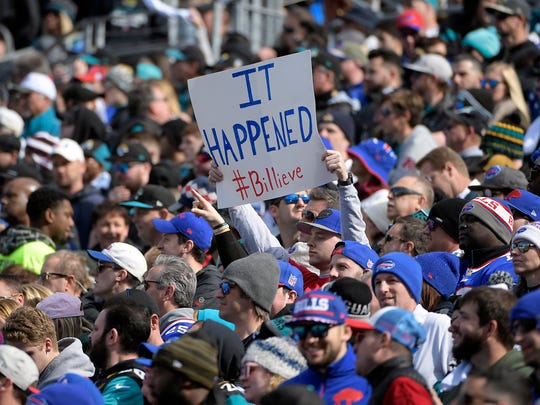 =a Buffalo Bills fan holds up a sign in the first half
