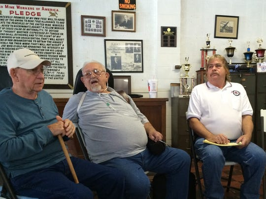 "Marvin Bruner (center) talks to Wilber ""Bud"" Groeninger (left) and Bil Musgrave about the now-closed southwest Indiana coal mine where they worked for years."