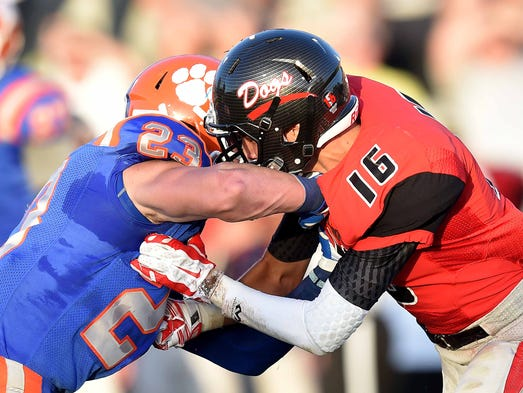 Madison Central's Will Brooks (left) and Brandon's Chad Butcher battle in the secondary during the 2014 football season opener on Friday, August 22, at Brandon High School.