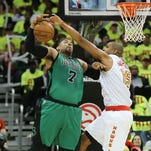Atlanta Hawks' Al Horford, right, blocks a shot by Boston Celtics' Jared Sullinger in Game 1 of the Eastern Conference playoffs.