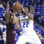 Cazmon Hayes is fouled as he goes to the basket against Charleston's Payton Hulsey in the second half of the Blue Hens' 62-59 win at the Carpenter Center this season.