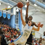 Indian River guard Kei Juan Major posterizes Sussex Tech guard Duane Hopkins last Friday night at Sussex Tech.