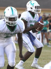 Fort Myers quarterback Edwitch Merisier eyes his receiver as North Fort Myers hosts Fort Myers Friday.