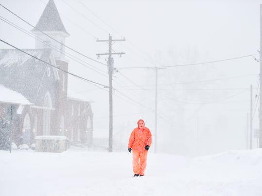 Bren Taylor, 14 of Hallam, walks on East Market Street to visit his grandmother, who also lives in Hallam, Saturday. A snow storm affecting much of the East Coast was expected to bring up to 3 feet of snow to York County,  through Saturday evening.