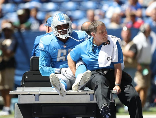 Kerry Hyder is carted off in the 2017 exhibition opener in Indianapolis.