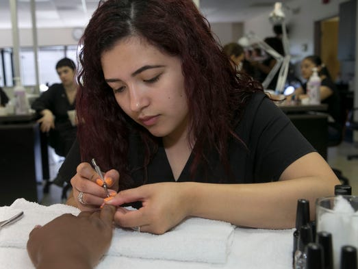 Maria Villegas, Belmar, gives a client a manicure at