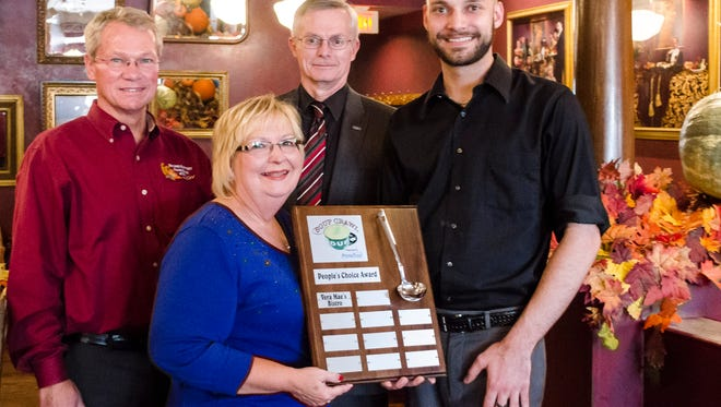 A traveling trophy is awarded to Vera Mae's Bistro for winning the 2015 Soup Crawl event Oct. 1, 2015 in Downtown Muncie. The photo, taken Nov. 4, shows the following individuals, from left to right: Tim Kean, President and CEO of Second Harvest Food Bank; Vickie Copley, Relationship Manager at PrimeTrust Financial; Jeffrey Sikora, President and CEO of PrimeTrust Financial; Nick Kirkpatrick, head chef at Vera Mae's Bistro.