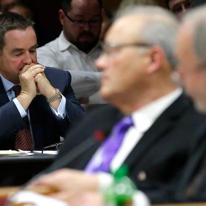 Green Bay Mayor Jim Schmitt listens to city council