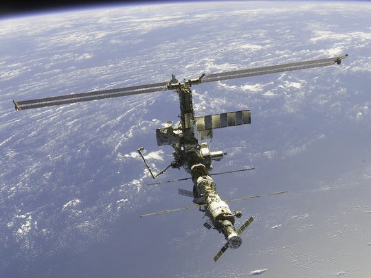 -The International Space Station is shown in an image taken by the STS-110 crew members on board the Space Shuttle Atlantis.